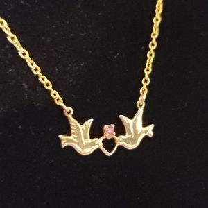 2 doves with a heart and pink gem necklace